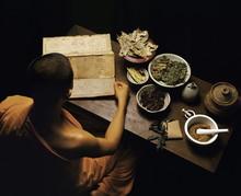 Thai Monk Preparing Herbal Medicines