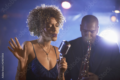 Female singer and saxophonist performing at the jazz club Wallpaper Mural