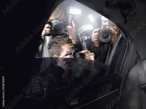 Fototapeta Paparazzi taking pictures through car window obraz