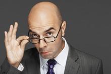 Portrait Of A Bald Businessman...