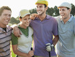 Cheerful young golfers with arms around on golf course