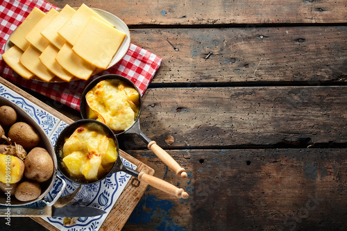 Fototapeta Delicious traditional Swiss melted raclette cheese obraz