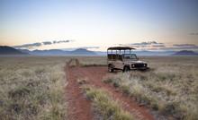Land Rover Game Vehicle Parked By Sand Road At Sunrise, Namib Rand Game Reserve, Namib Naukluft Park, Namibia
