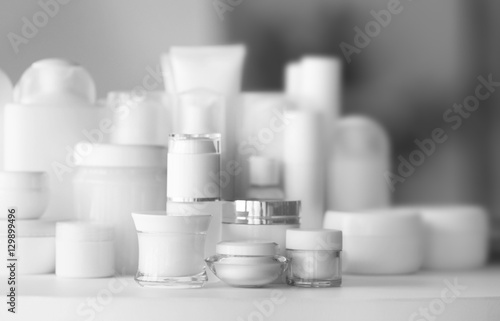 Fotografía  Set of cosmetics on white table against blurred background, close up view