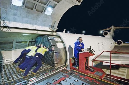 Airfreight loading onto Boeing 727 - Buy this stock photo