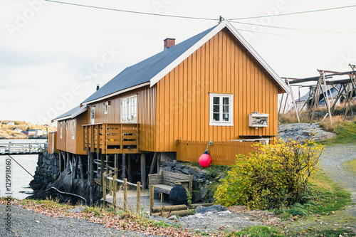 Foto op Aluminium Arctica Fishing village in Scandinavia. Traditional wooden houses. Wooden pier. Coast sea, sunset.