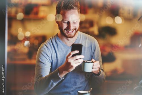 Cheerful businessman drinking coffee