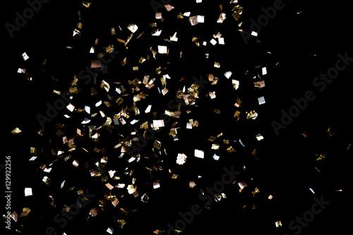 Obraz Golden confetti on black background - fototapety do salonu