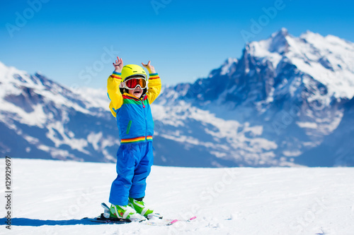 Fotografie, Obraz  Ski and snow fun for child in winter mountains
