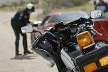 Closeup Of Motorcycle With Traffic Cop And Car In Background