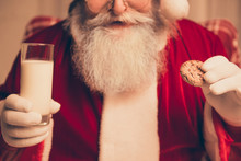 Close Up Of Happy Santa Claus With Glass Of Milk And Cookie