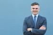 Mature businessman smiling wearing classic suit