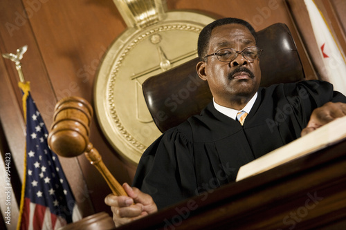 An African American male judge forming sentence in the courtroom Poster Mural XXL