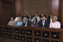 Group Of Jurors Sitting Together In Jury Box During Trial