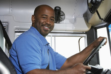 Portrait Of An African American Bus Driver In School Bus