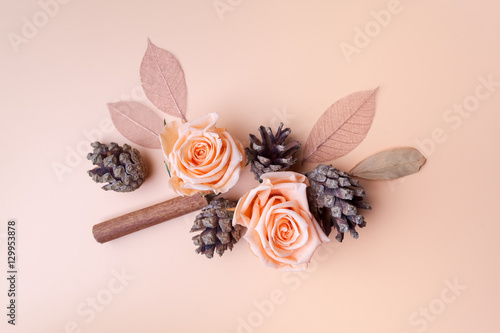 Fototapeta Christmas composition cinnamon sticks, roses and cone top view on pink background. flat lay obraz
