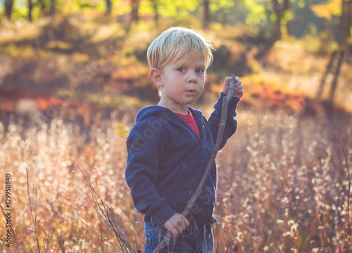 Fotografie, Obraz  Portrait of Child Standing in a Field in Autumn