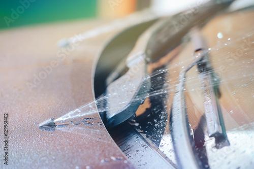 Fotografie, Obraz  windscreen washer at the moment work