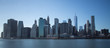 New York financial district with skyscrapers over East River