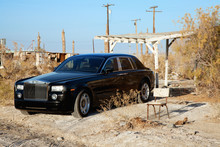 Rolls Royce Parked Next To Bro...