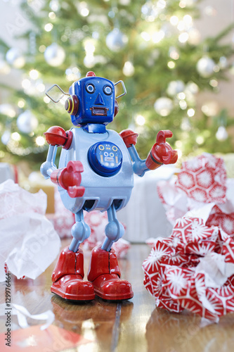 Fotografia, Obraz  Retro style toy robot in front of Christmas tree