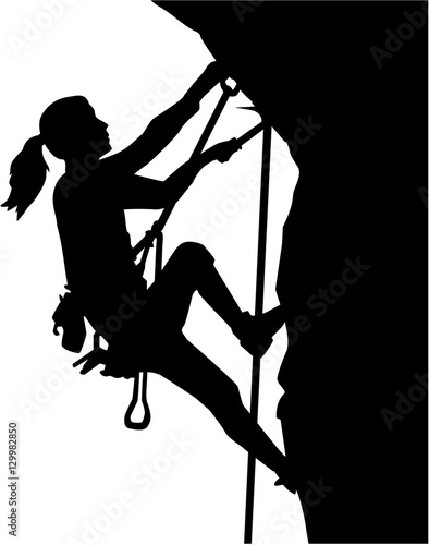 Female climber silhouette in ropes an a rock Fototapeta