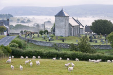Early Morning Mist In The Valleys Surrounds St. David's Church, Llanddewi'r Cwm, Powys, Wales