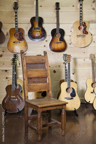 Spoed Foto op Canvas Muziekwinkel Electric guitars with chair in the room