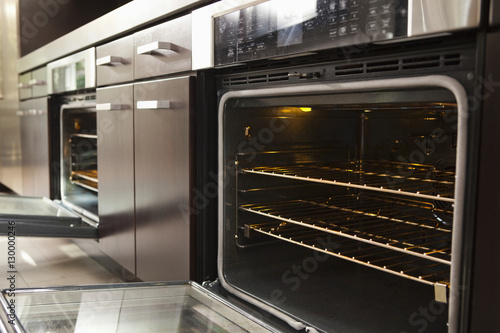 Closeup of open oven in commercial kitchen