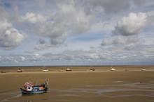 Boats On The Beach Near New Brighton, Wirral Peninsula, Merseyside