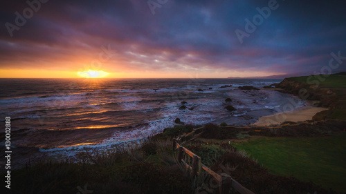 Foto op Plexiglas Chocoladebruin Dramatic sunset at Half Moon Bay beach