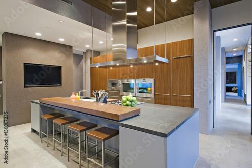 Bar stools at breakfast bar in contemporary kitchen - Buy ...
