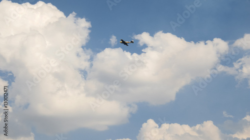 Foto op Canvas Luchtsport old historical military soviet russia plane flying and performs aerobatics - dead loop, slow motion