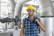 Young male worker holding wrench in industry