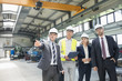 Businessman discussing with colleagues in metal industry