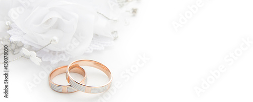 Wedding rings on wedding card on a white background, border design panoramic ban Canvas Print