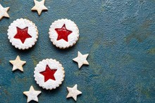 Cookie Stars. Homemade Ginger Cookies With Strawberry Jam. Copy Space. Flat Lay. Shortcrust Pastry. Traditional Austrian Linzer Cookie On Green Background. Top View.