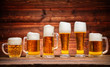 Glasses of lager served on old wooden planks