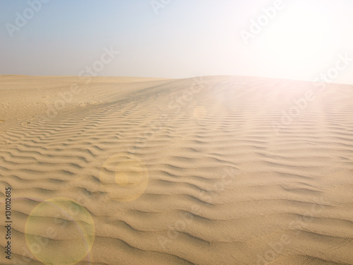 Foto op Plexiglas Zandwoestijn Sunset over the Sahara Desert
