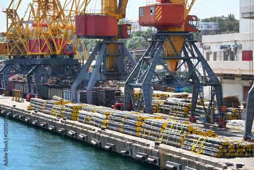 Photo  new pipes in the industrial port, cargo cranes and infrastructure