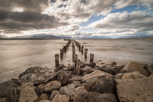 Boat Pier With Old Logs And Stilts For Landscape Travel Background