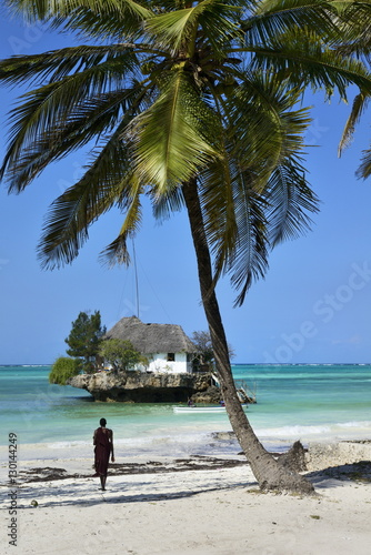 Masai tribesman on Bwejuu Beach, The Rock Restaurant, Zanzibar, Tanzania, Indian ocean, East Africa, Africa