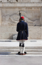 Greek National Guard Soldier (Evones) Guarding The Tomb Of The Unknown Soldier Outside The Vouli Parliament Building, Athens, Greece