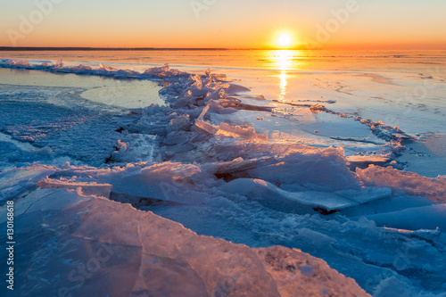 Printed kitchen splashbacks Cappuccino crack in the ice on a frozen lake at sunset