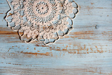 Handmade Lace On Shabby Chic, Painted, Blue Wood. Macrame Close-up, Top View With Copy Space. Wedding Or Holiday Background.