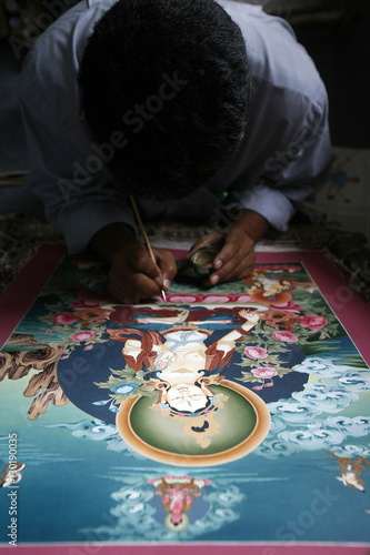Painting A Thangka Depicting White Tara Goddess Buddhist Symbol Of