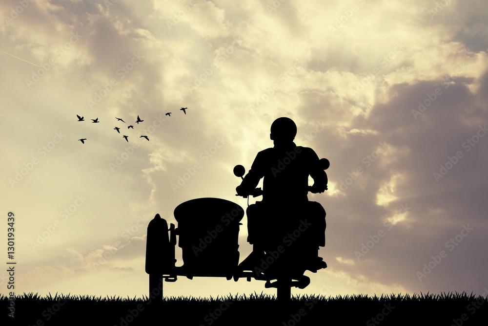 Fototapeta man on sidecar at sunset