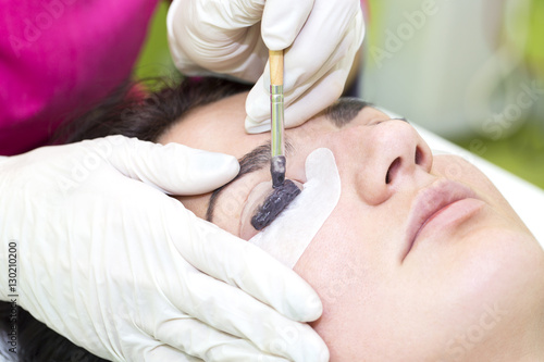 Poster  Woman on the procedure for eyelash extensions, eyelashes lamination