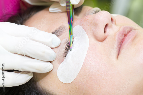 Leinwand Poster Woman on the procedure for eyelash extensions, eyelashes lamination