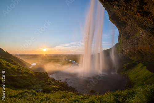 Foto op Canvas Watervallen Behind Seljalandsfoss during a Sunset